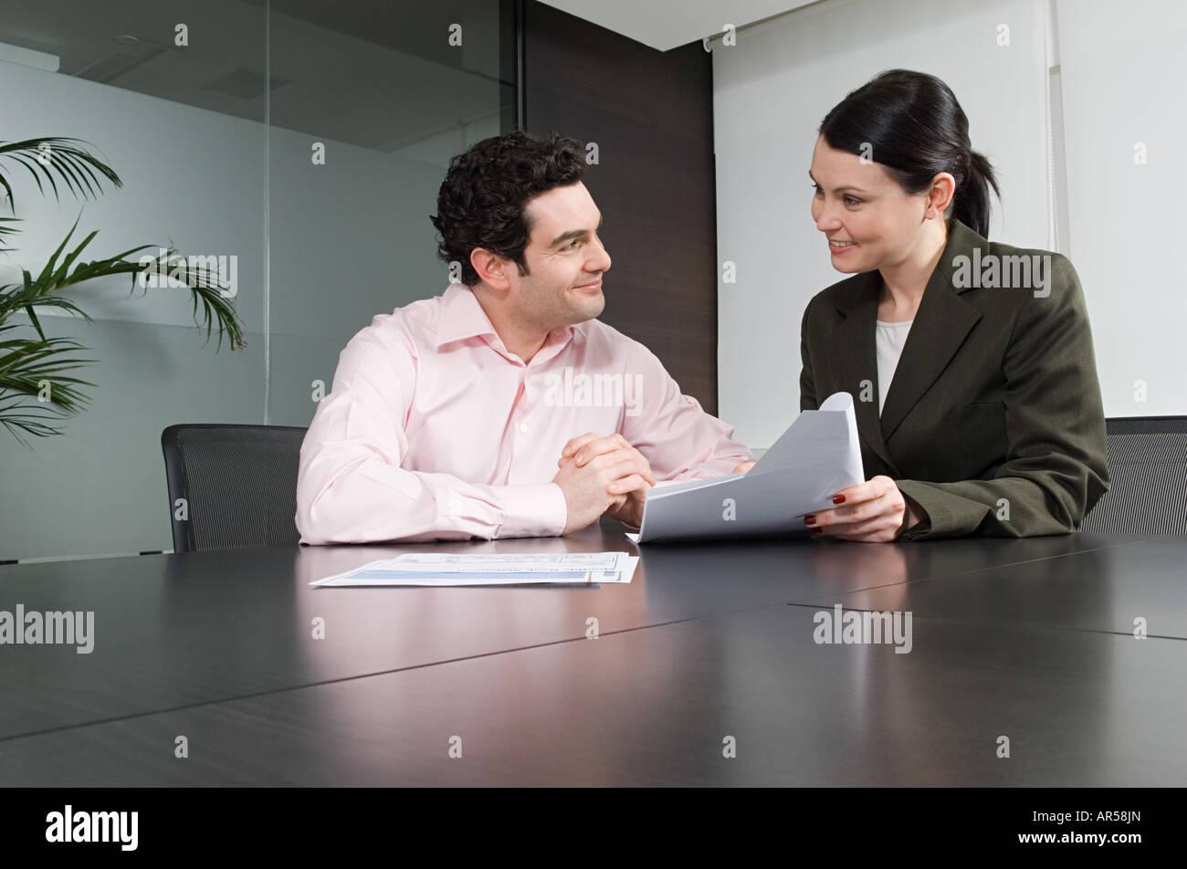 Bank manager helping customer - Stock Image
