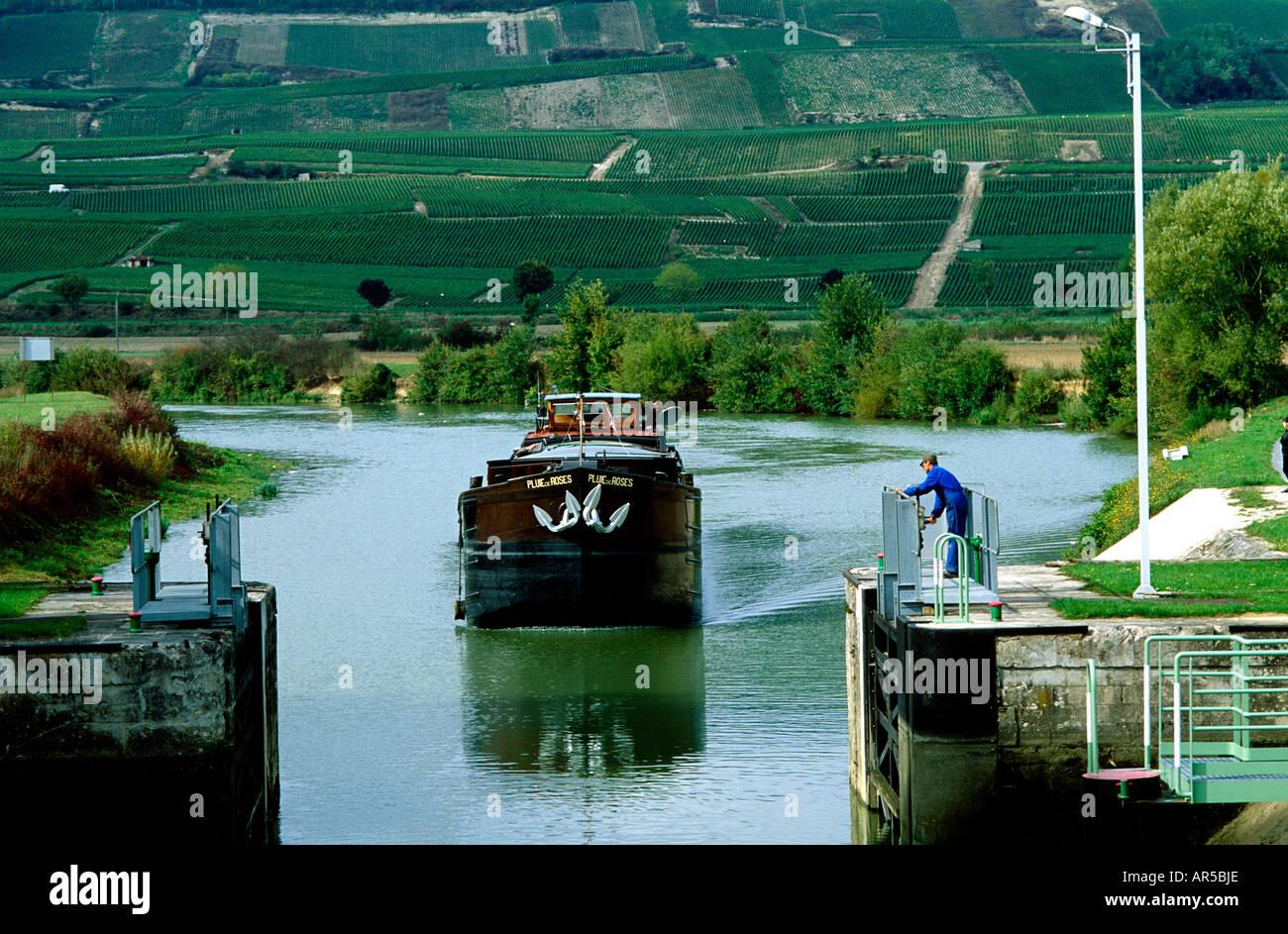 France Champagne District Canal de la Marne at Ecluse des Vaudières. Freighter passing Paris to Reims. Champagne vineyards - Stock Image