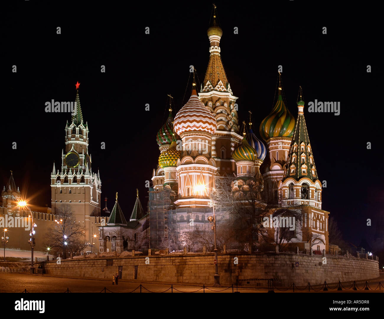 A general view of Saint Basils Cathedral and Kremlin pictured in the city of Moscow at night - Stock Image