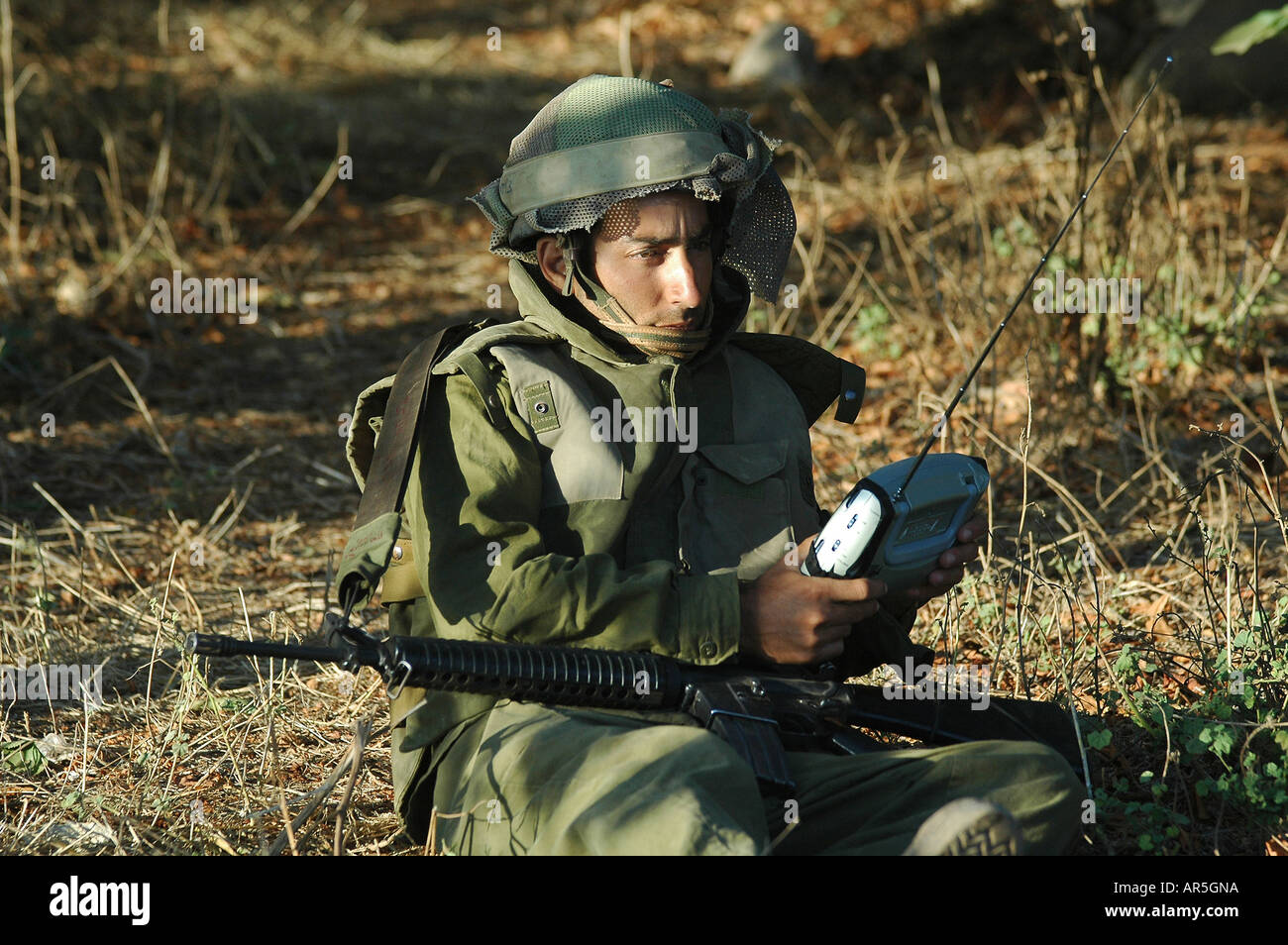 An Israeli soldier listening to a portable radio at the Lebanon border on the last day of Israel Hezbullah war in 2006 - Stock Image