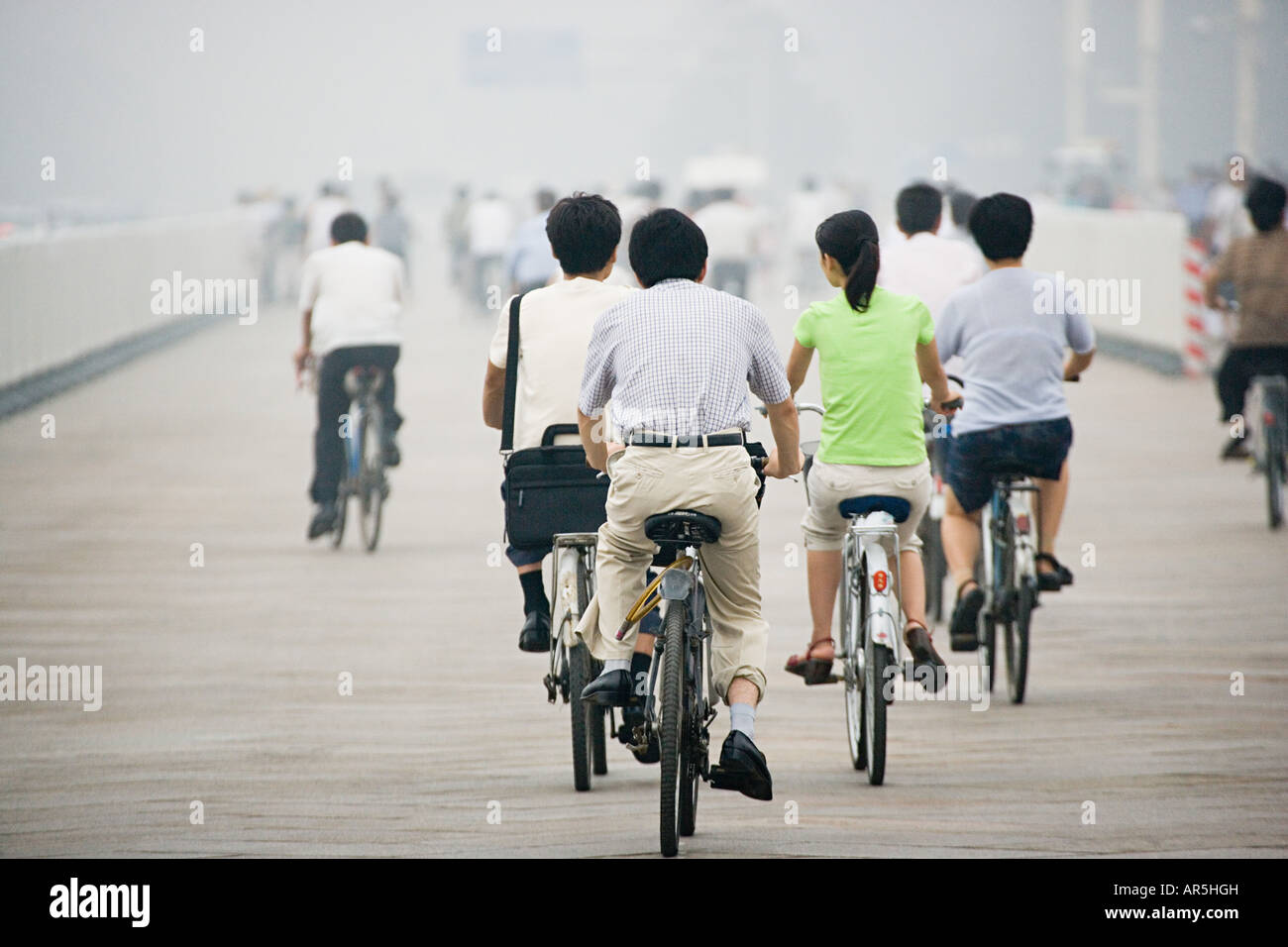 Chinese people cycling - Stock Image