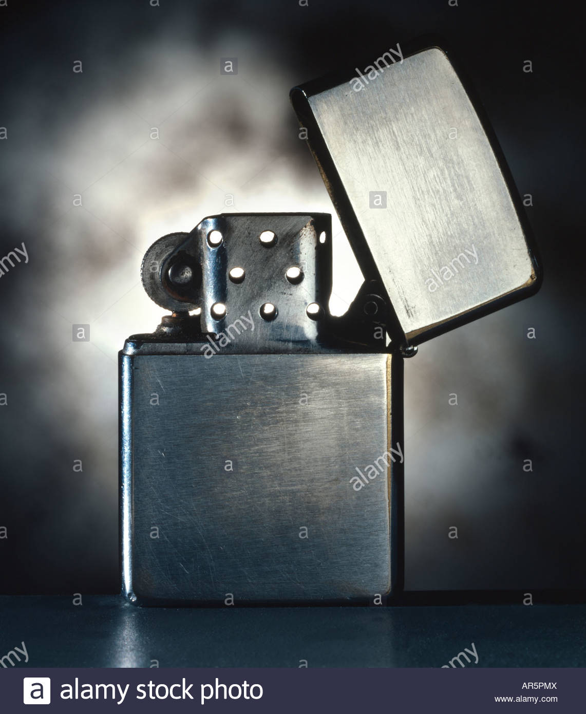 Old silver zippo lighter - Stock Image