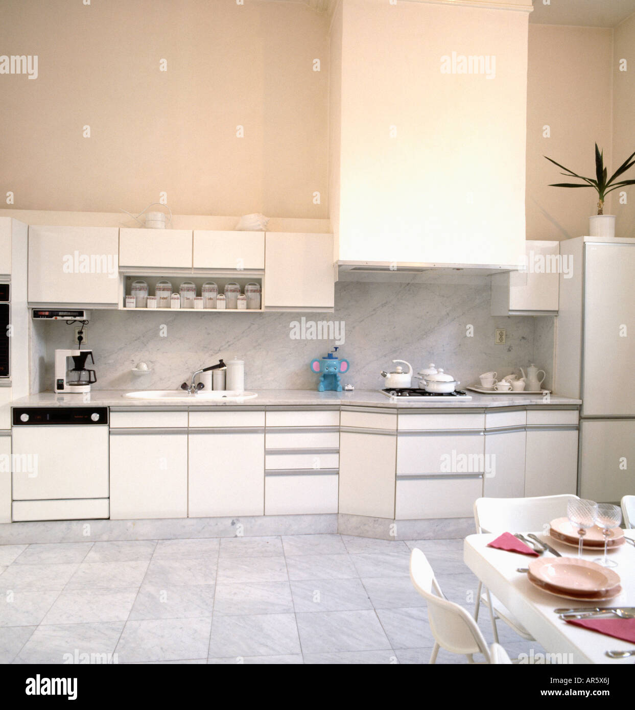 Grey Marble Floor Tiles In Neutral Eighties Fitted Kitchen Stock Photo Alamy