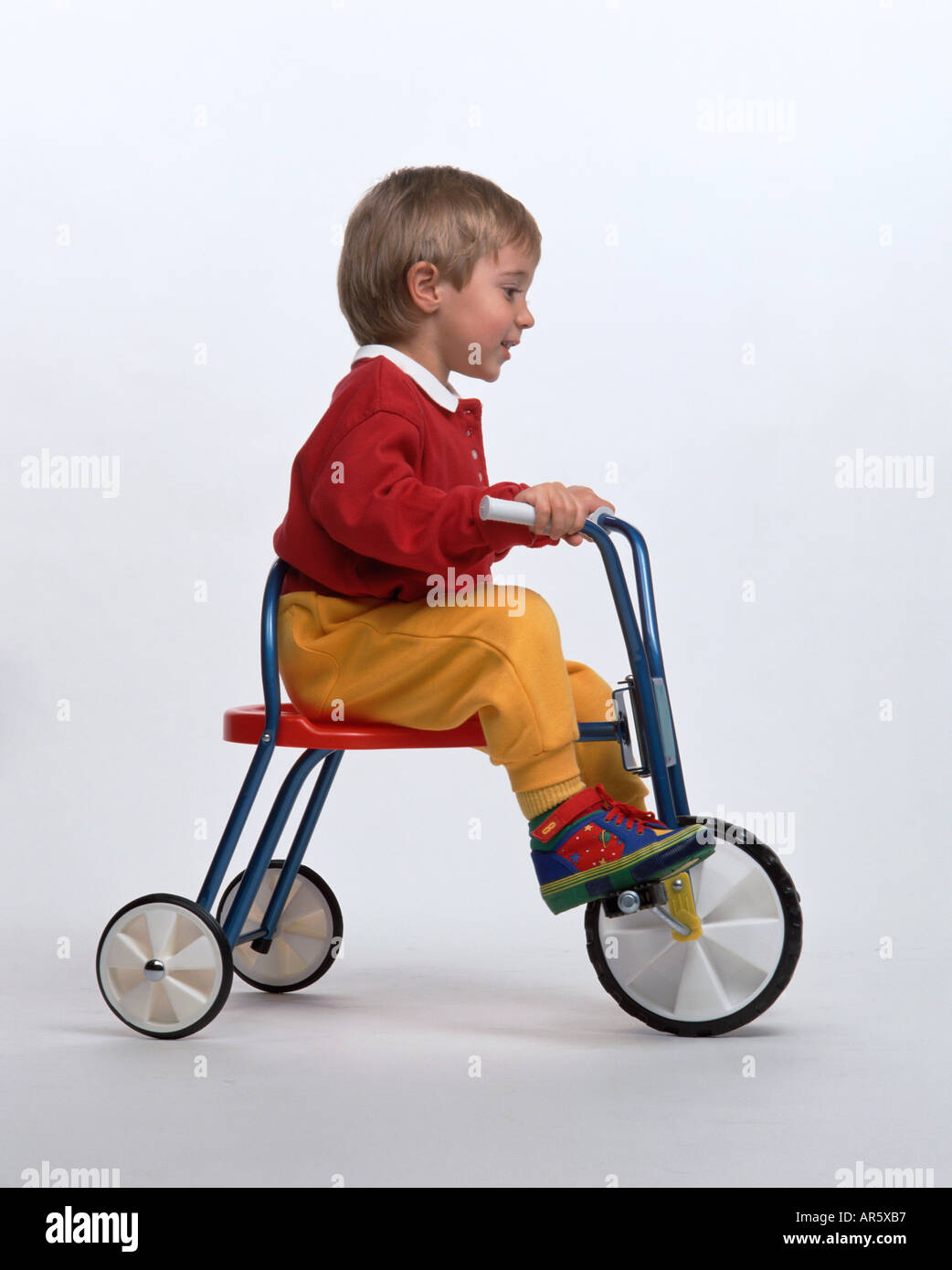 Little boy on a tricycle - Stock Image