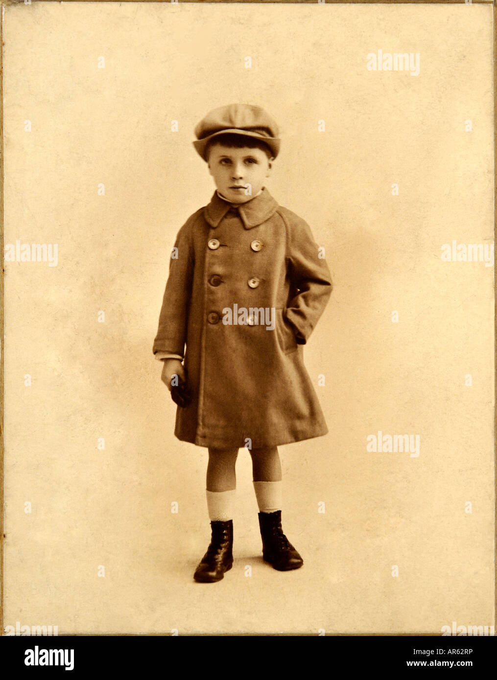Edwardian Boy in old sepia photograph by anonymous photographer 1900s - Stock Image