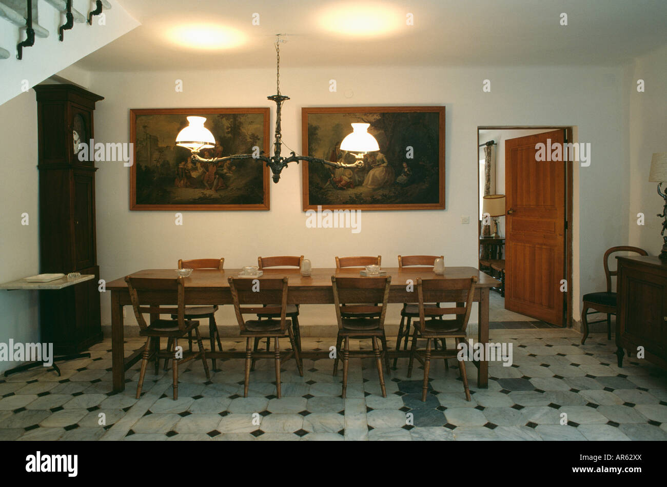 Attractive Victorian Style Lighting Above Rectangular Wooden Table And Chairs In  Seventies French Dining Room With Grey Floor Tiles