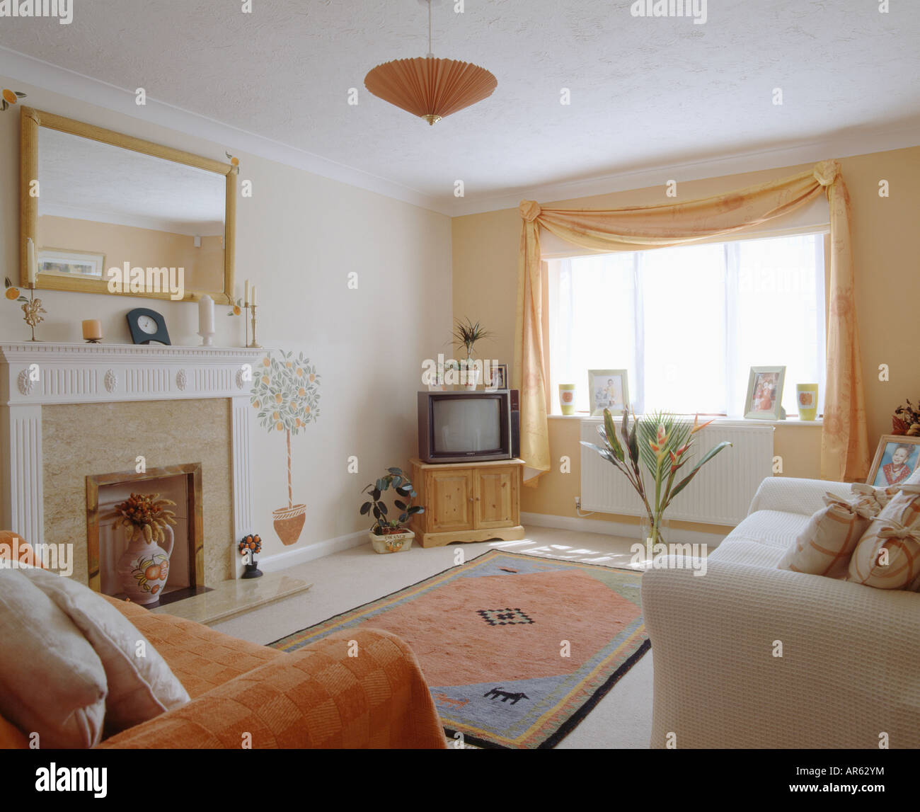 Television On Cupboard In Corner Of Living Room With Mirror Above The Stock Photo Alamy