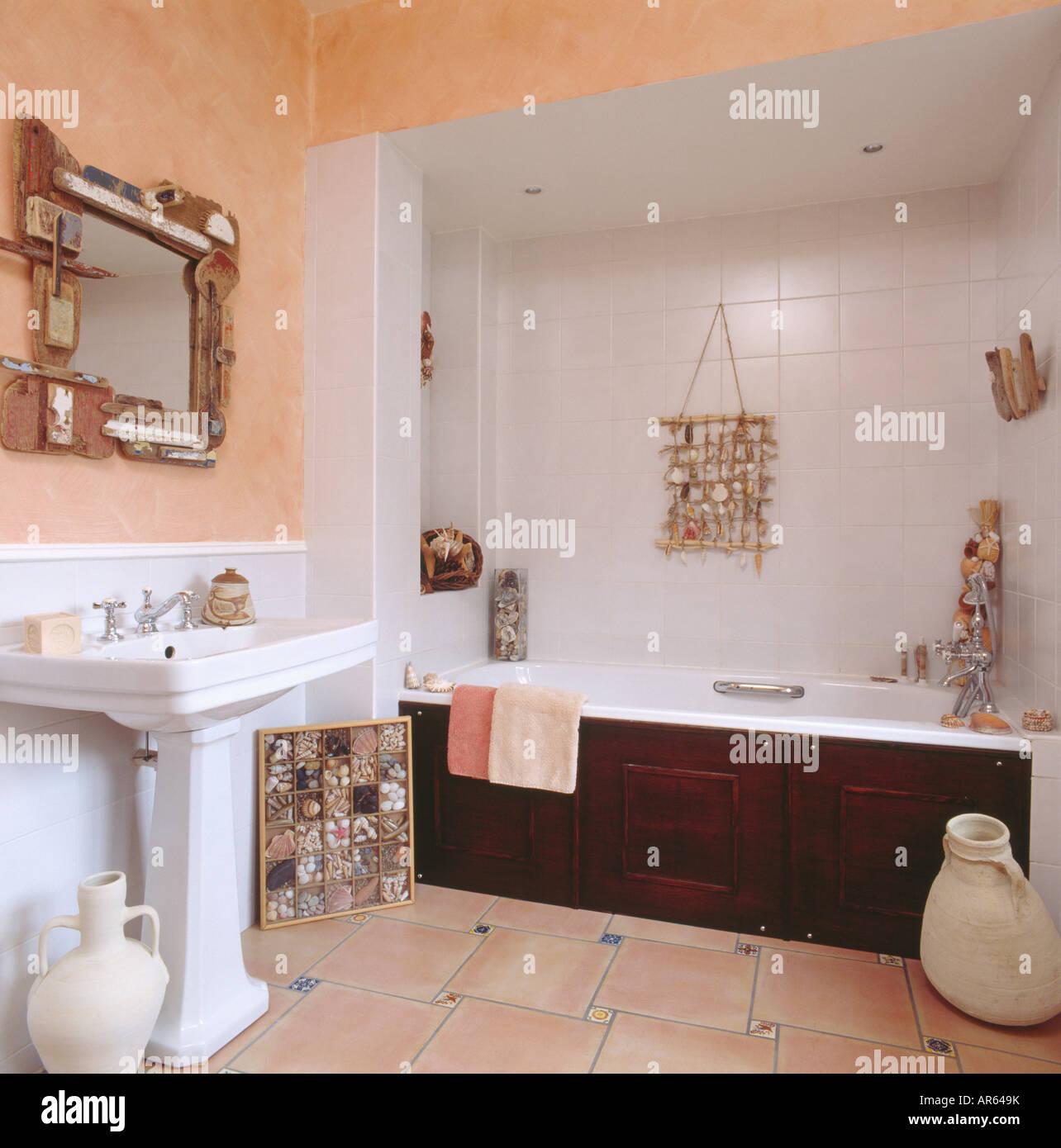 Popular Driftwood mirror above white pedestal basin in peach bathroom with  UU34
