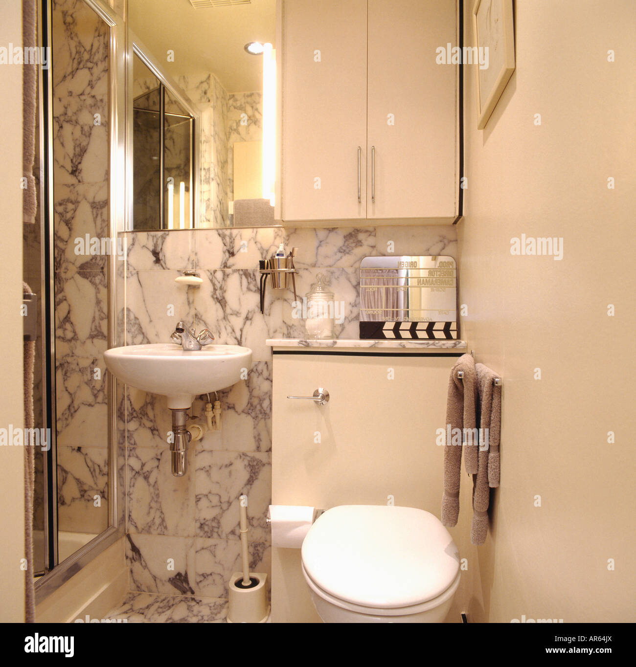Wall Mounted White Basin And Marble Tiles In Small Modern White Stock Photo Alamy