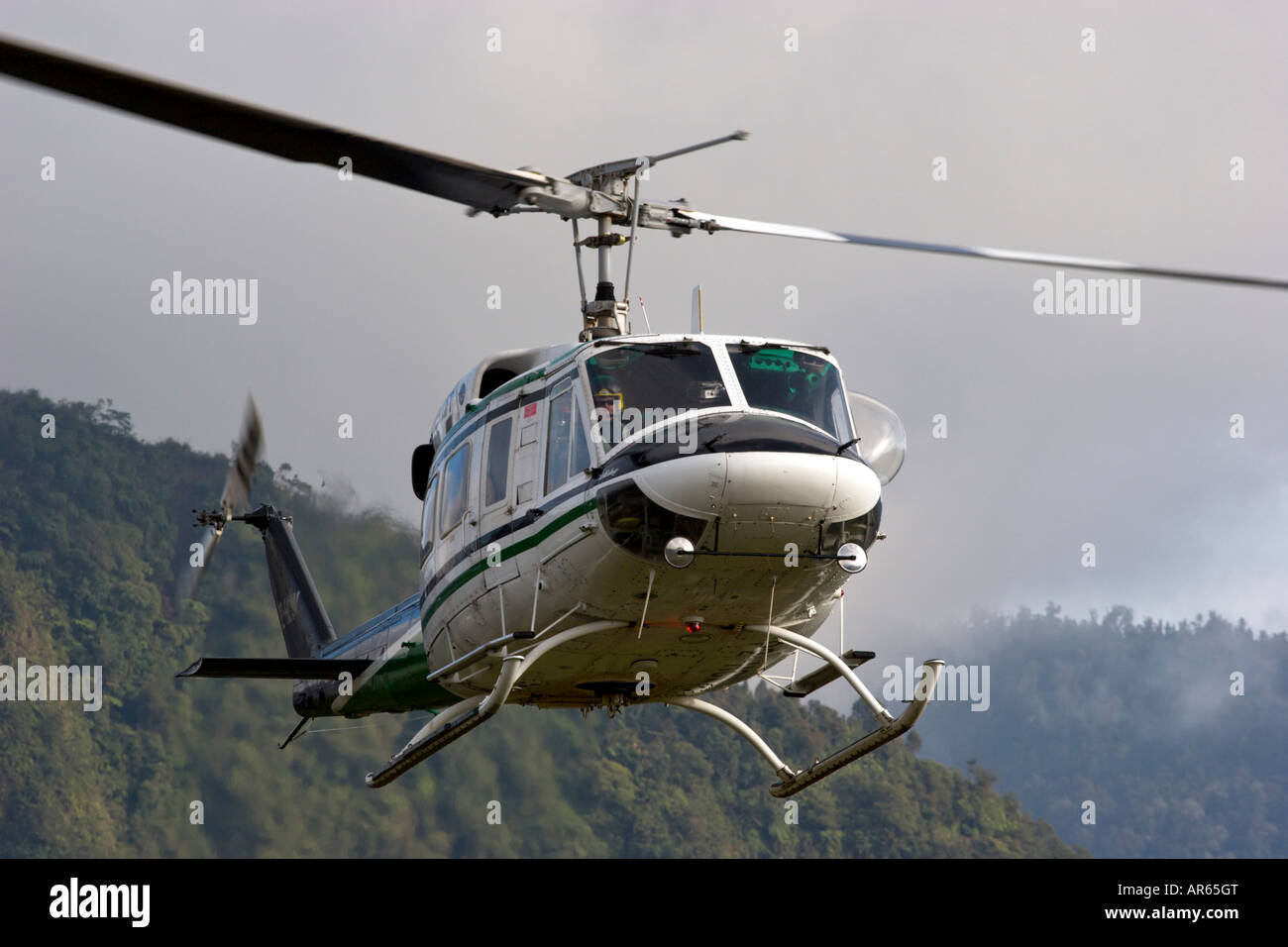 bell 212 twin working flying - Stock Image