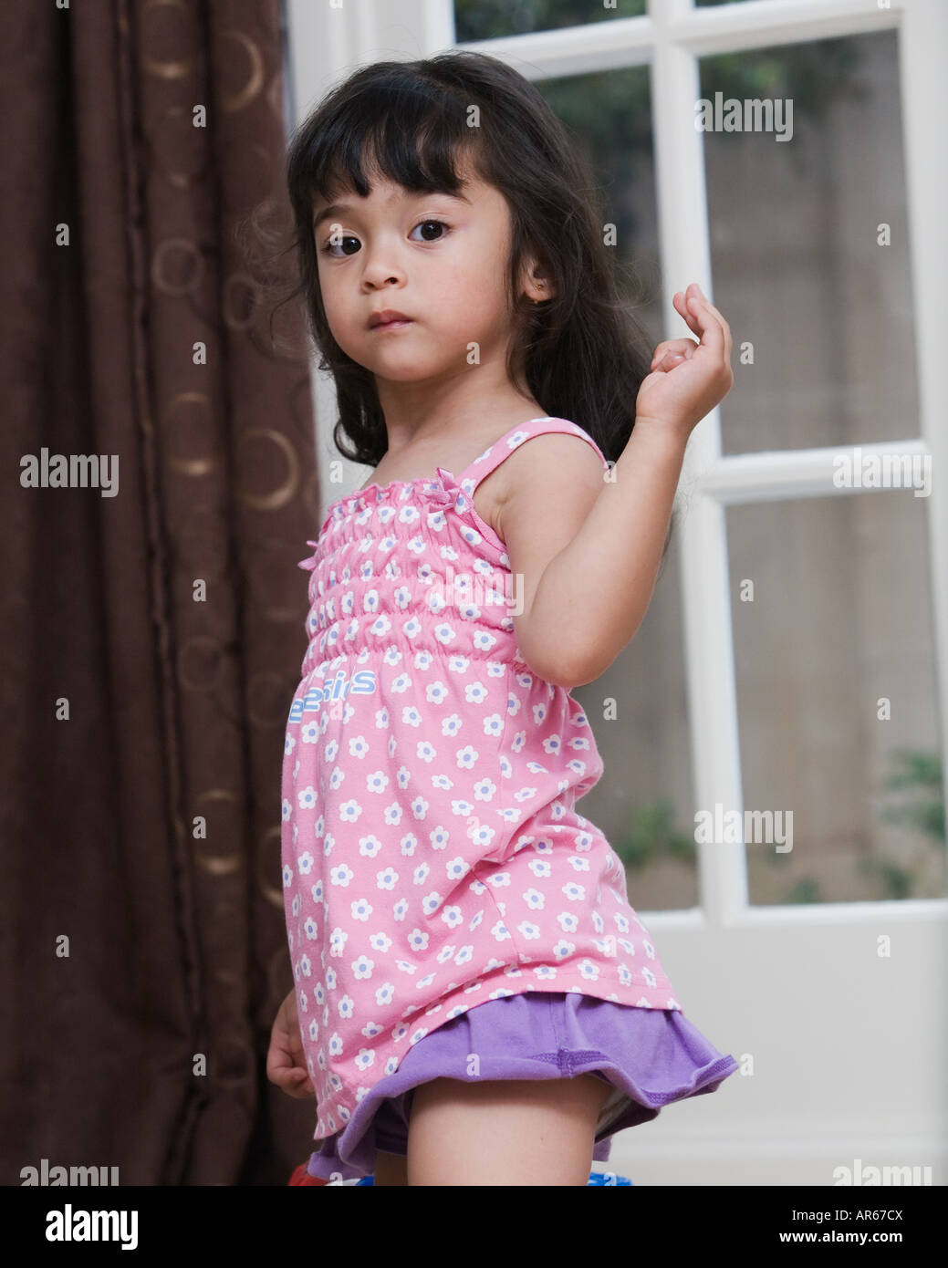 Little girl in pink - Stock Image
