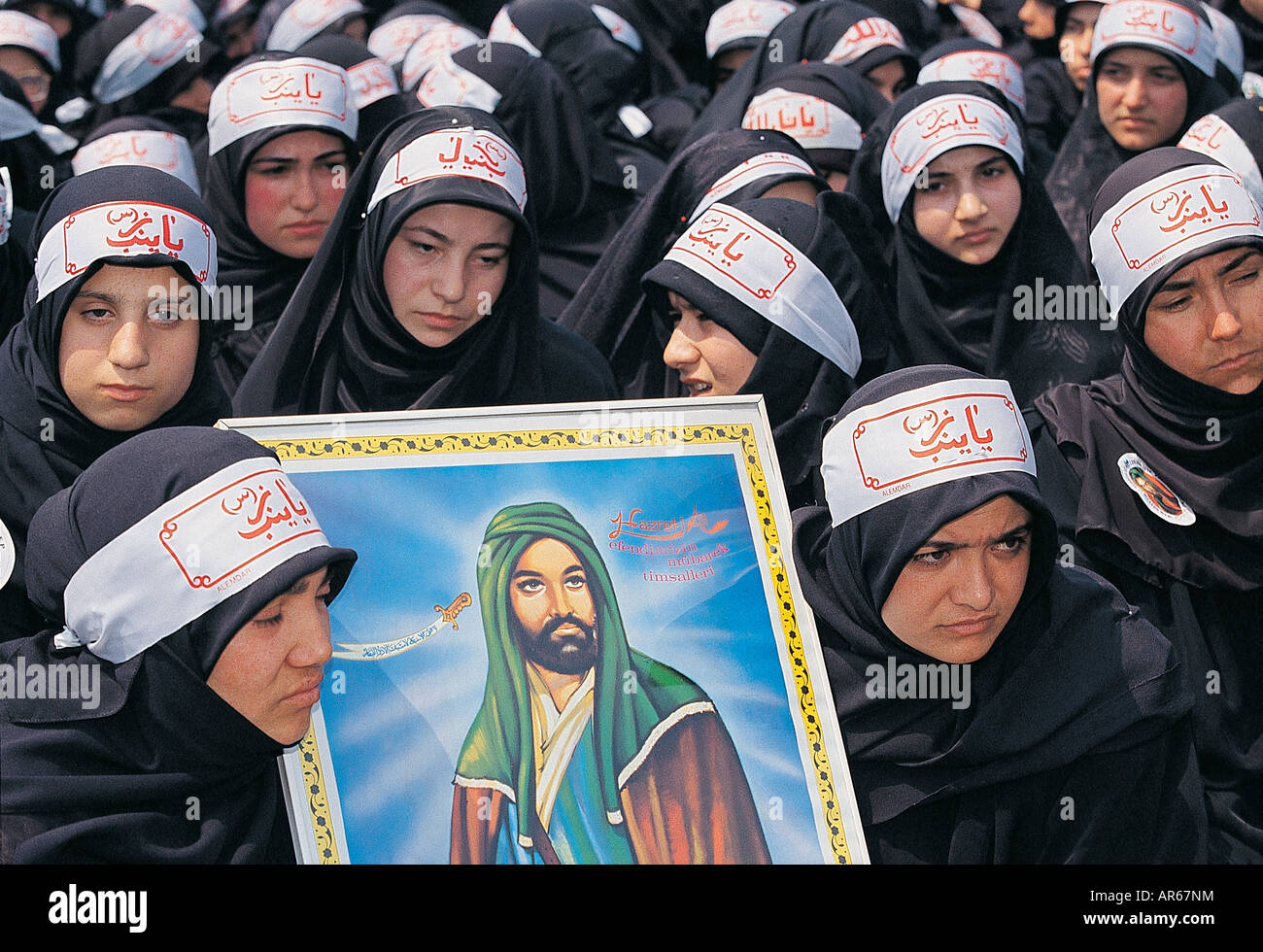 Shiite Muslim girls mourning for Al Hussain on the Ashura day in Istanbul Turkey . - Stock Image
