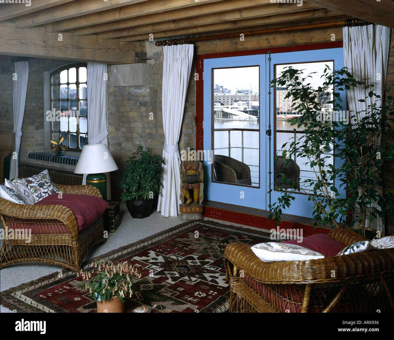 Show Flat, New Concordia Wharf, Docklands. Living area with view through window. - Stock Image