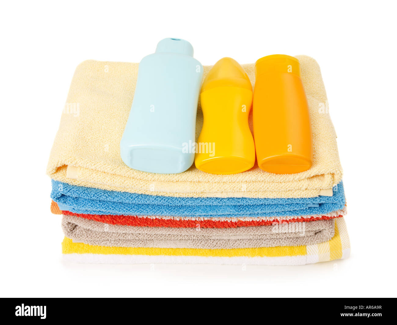 Suntan lotion and beach towels - Stock Image
