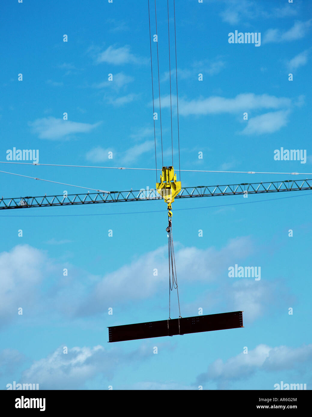 Industrial crane holding a girder Stock Photo