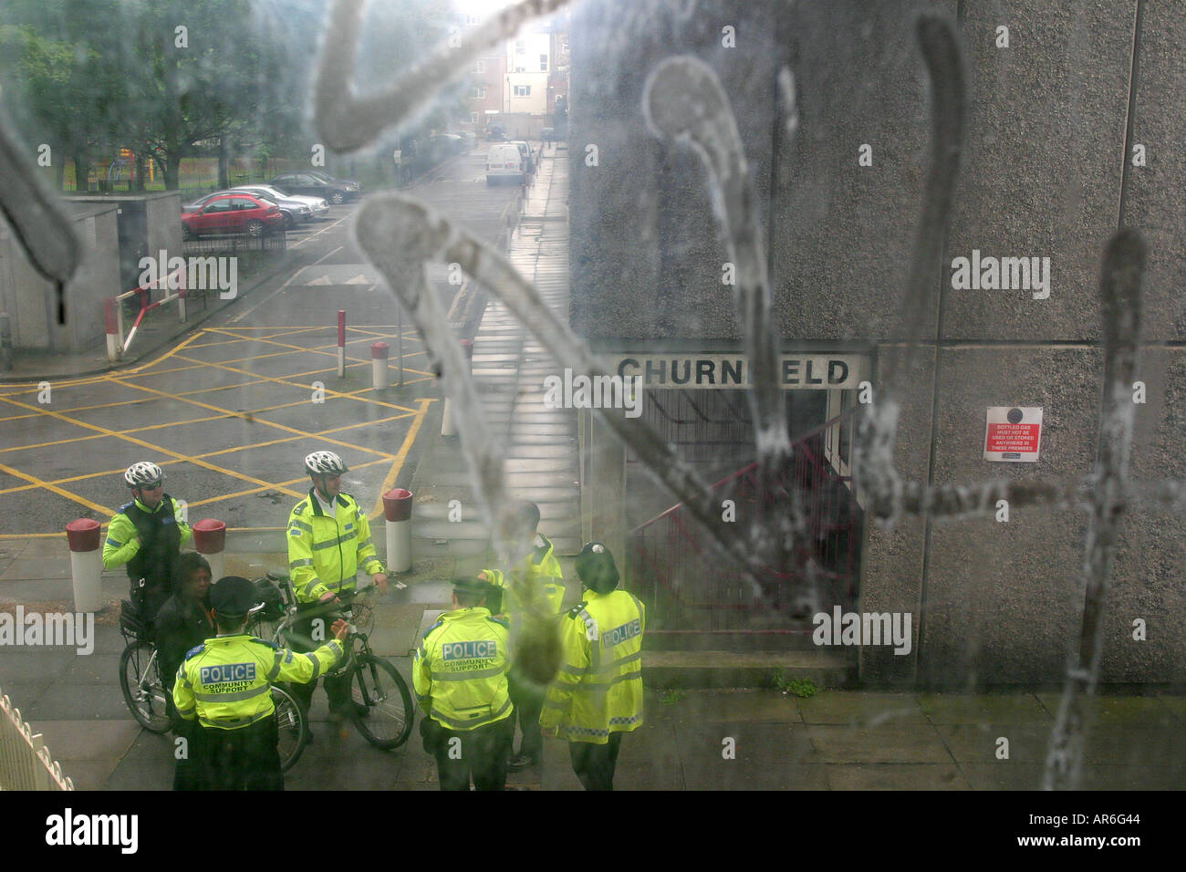 Police meet to patrol an anti-social behaviour exclusion zone on a housing estate, Finsbury Park, London, uk. - Stock Image
