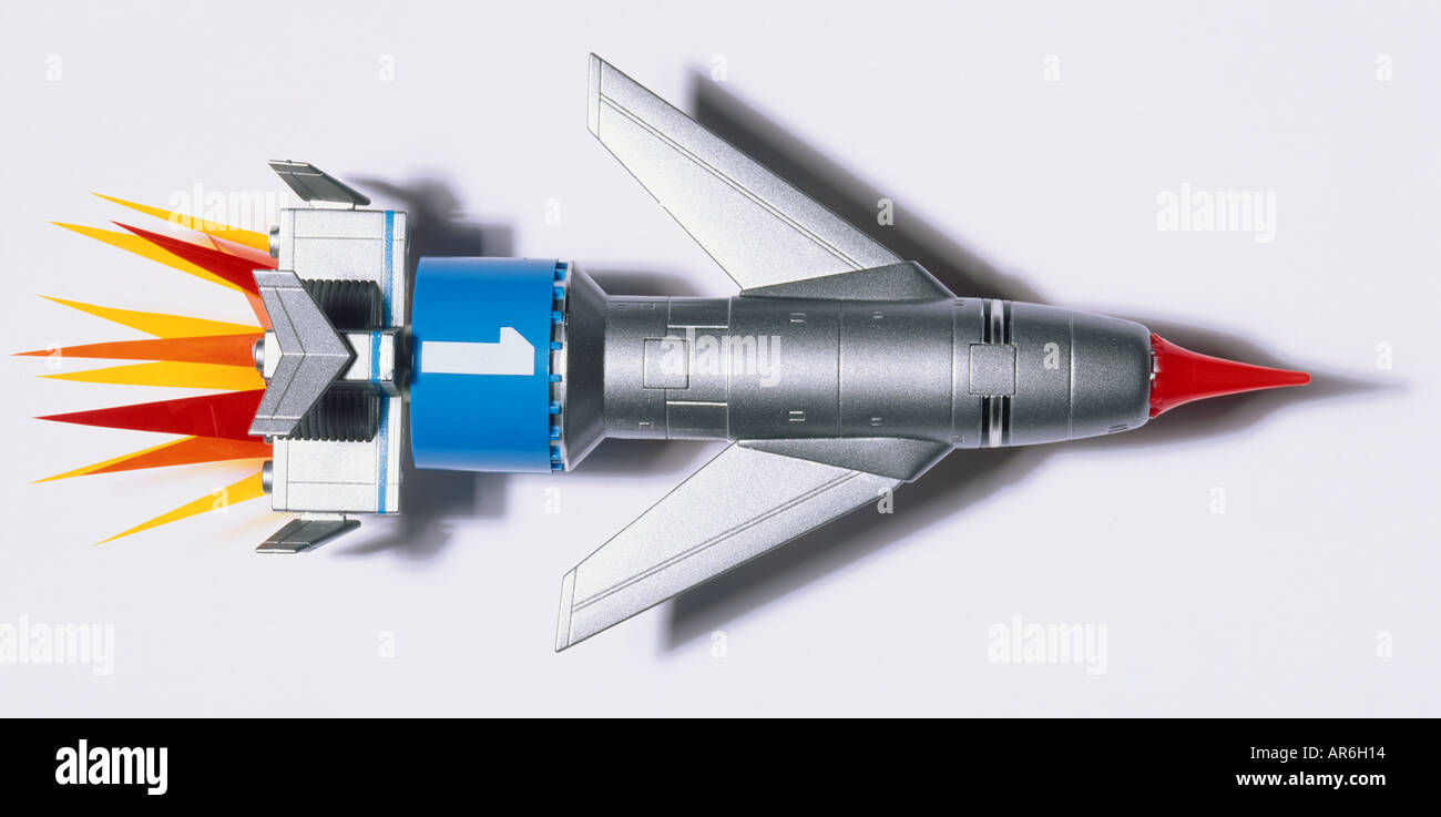 Model of a space rocket launching, steel coloured body with red nose and blue band with number one drawn - Stock Image