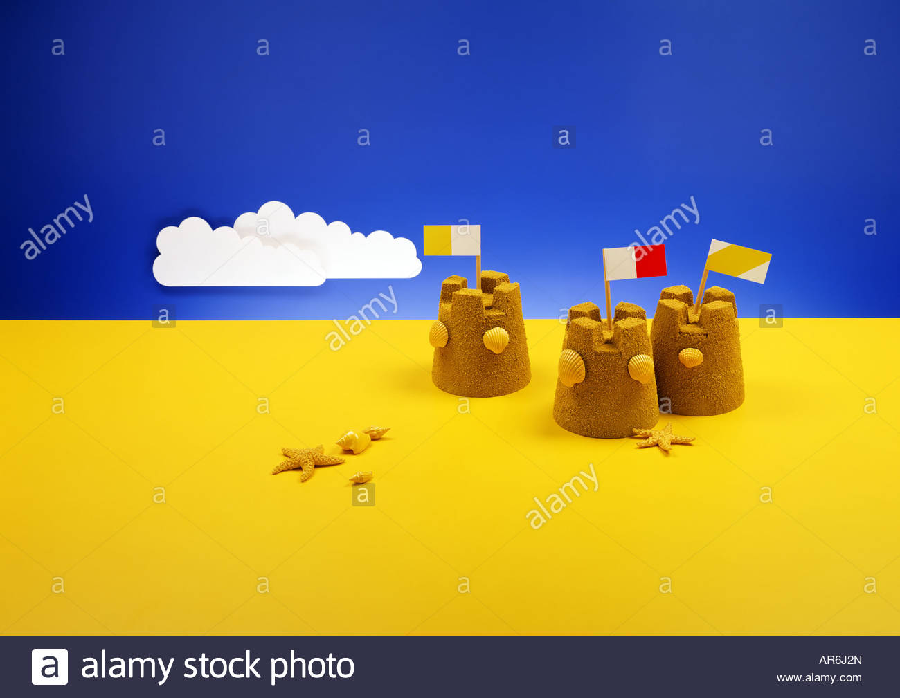 stylised beach with sandcastles - Stock Image