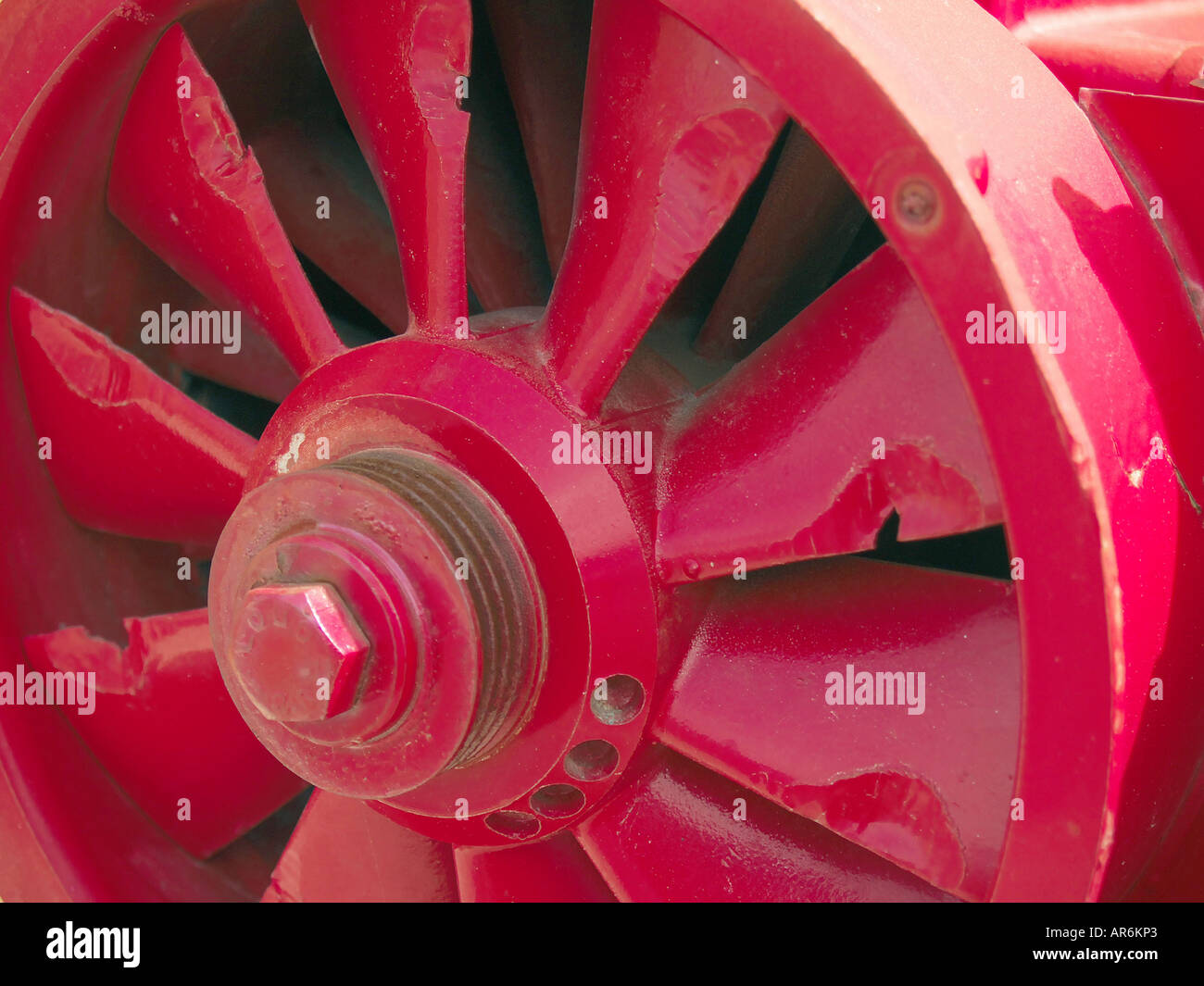 Close view of a large red industrial turbine with cracked fins. Stock Photo