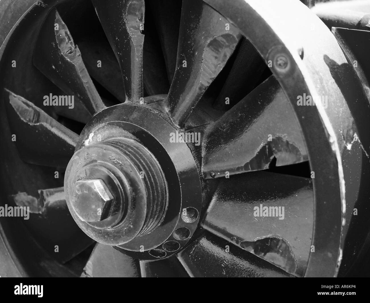 Close view of a large industrial turbine with cracked fins in black and white. Stock Photo