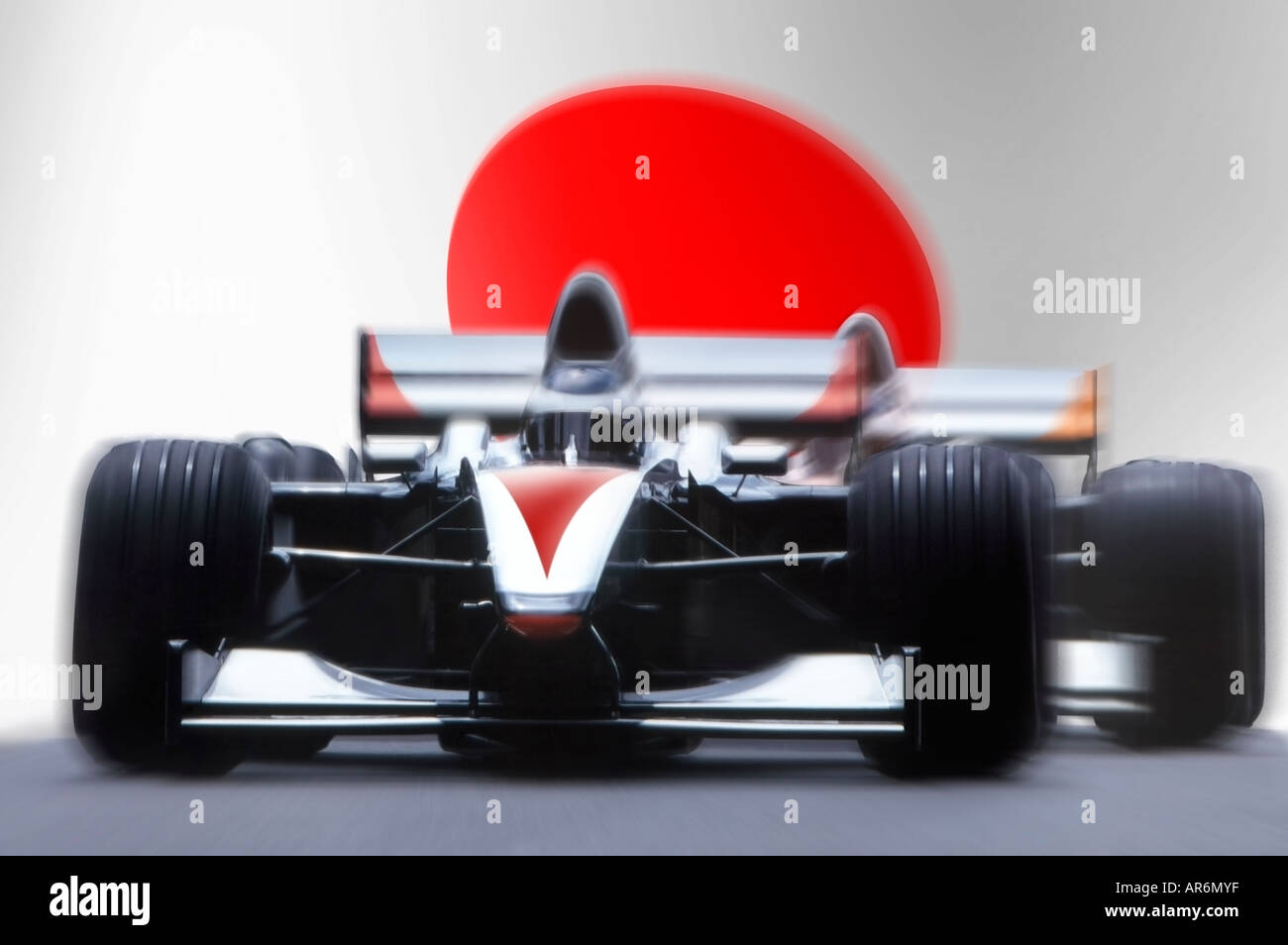 formula racing car in front of national flag Stock Photo