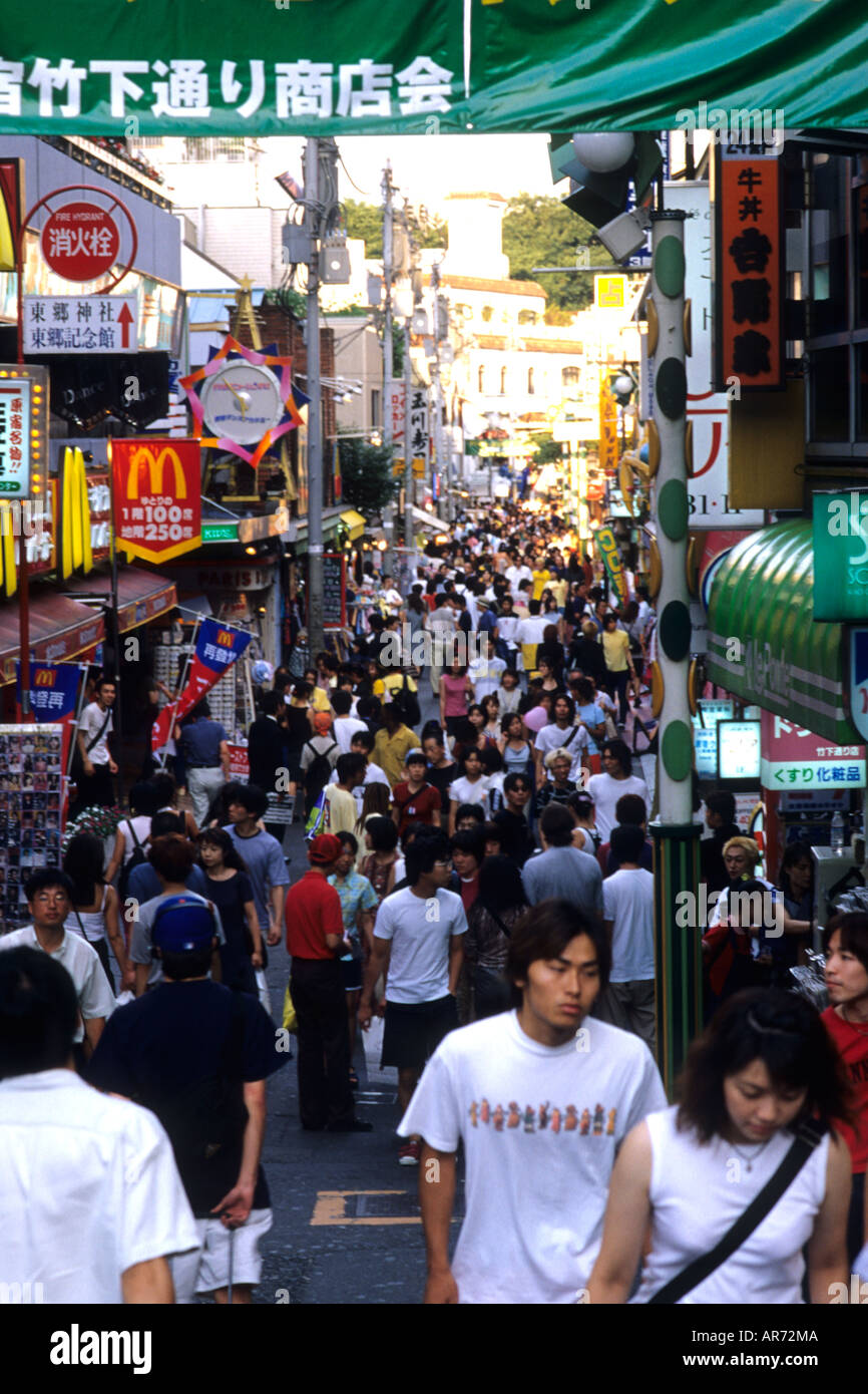 Teenagers in modern era at crazy wild Harajuku Street meeting place in Tokyo Japan - Stock Image