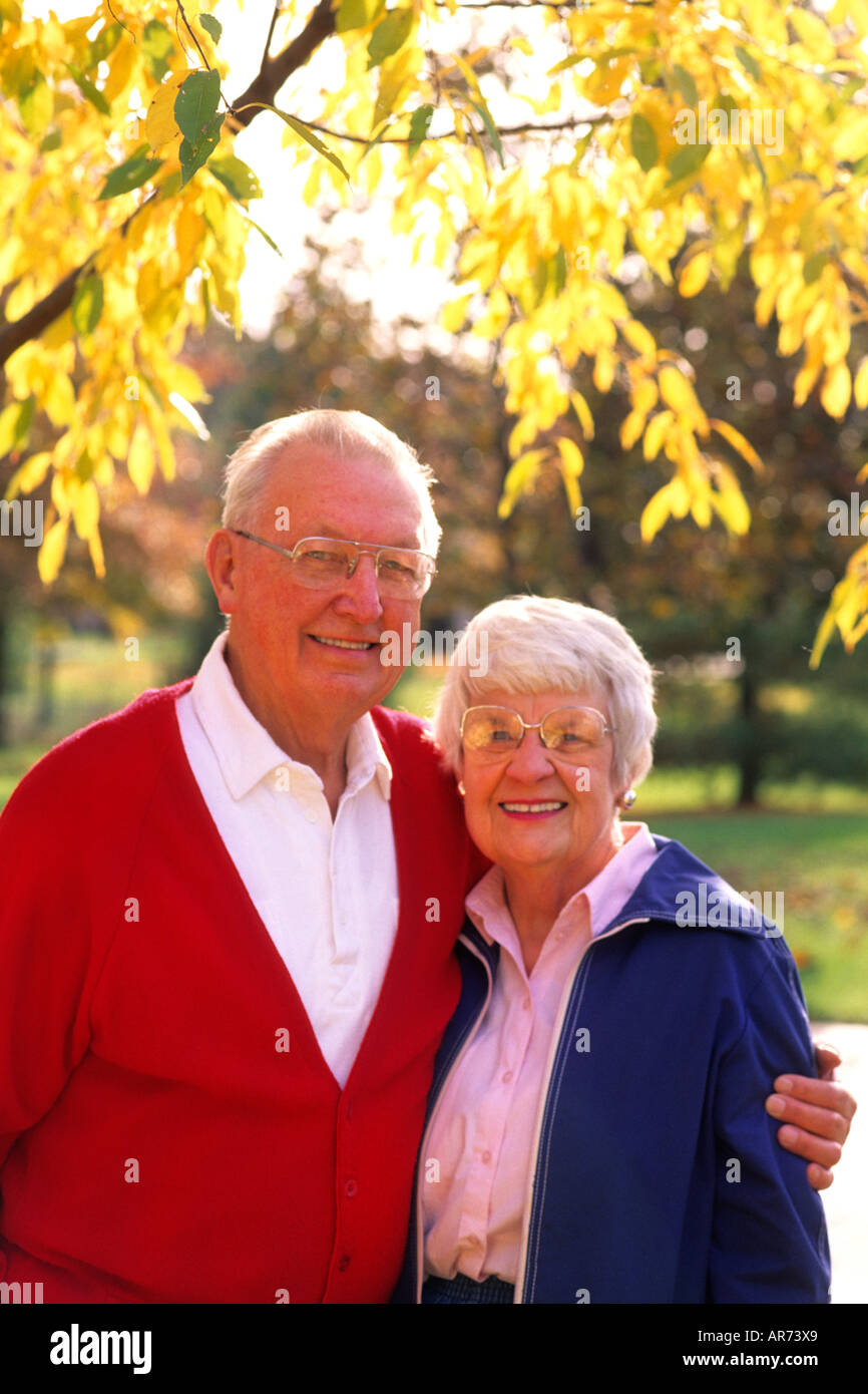 Retired couple portrait in the fall colors age of seniors is 80s - Stock Image