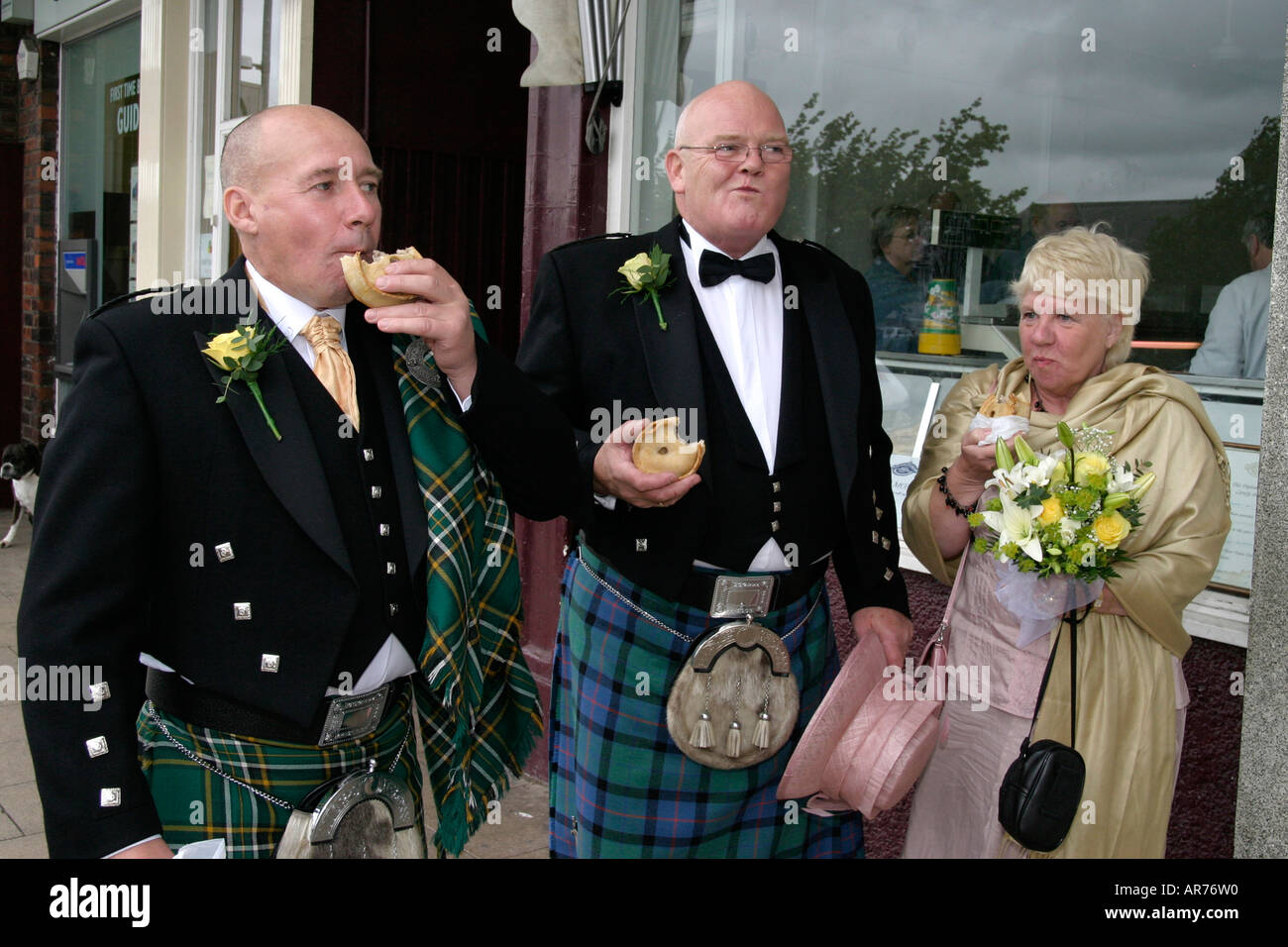 Wedding guests eating out in Gretna Green Scotland - Stock Image