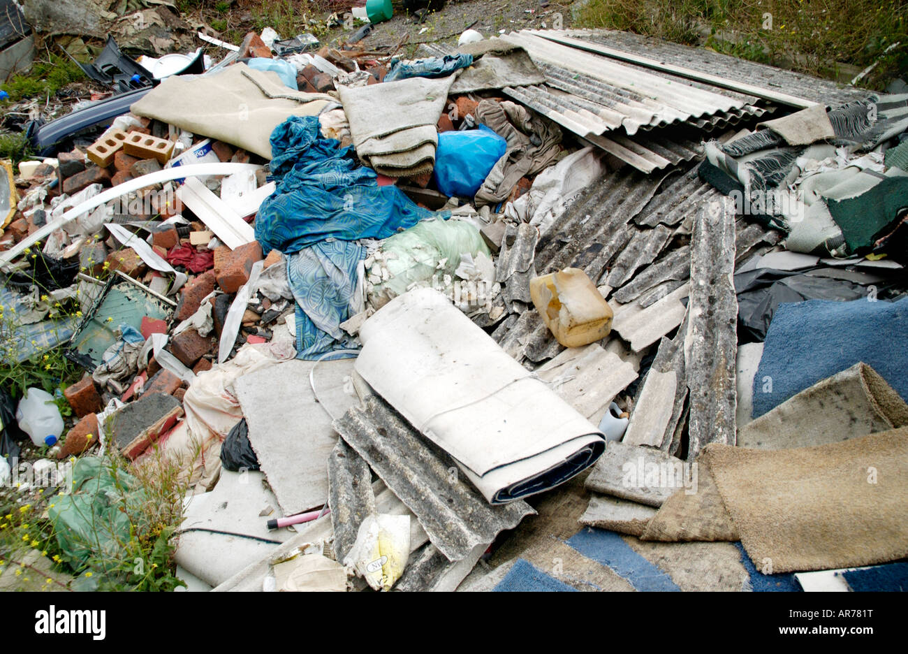 Household rubbish dumped on waste ground near the city centre Newport South Wales UK EU - Stock Image