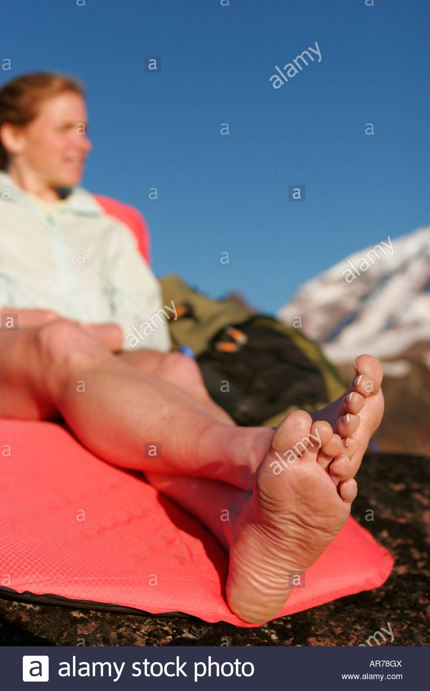 Jane Matera relaxes on her woman s ThermaRest Prolite mattress after a long hike Spray Park Mt Rainier National - Stock Image