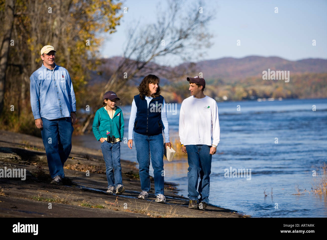 Family walks along the banks of the Connecticut River in Holyoke, Massachusetts. - Stock Image
