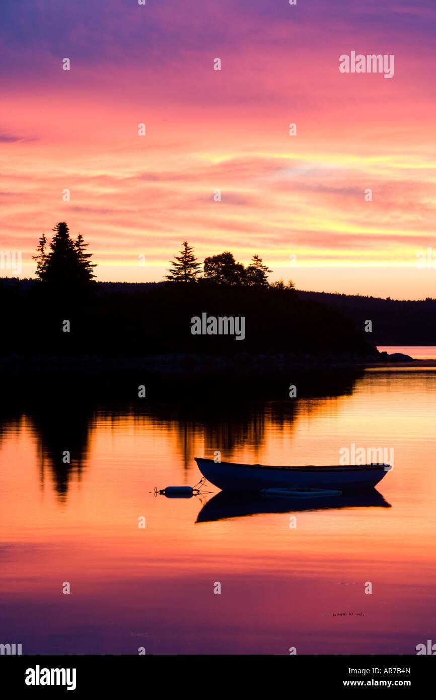 A skiff at sunrise in Eggemoggin Reach in Little Deer Isle, Maine. - Stock Image