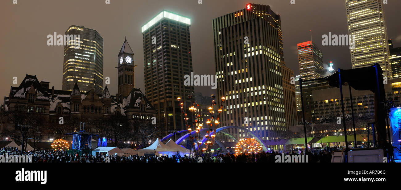 Panorama of Old City Hall and Toronto Financial towers during Wintercity Nights of Fire at night in winter - Stock Image