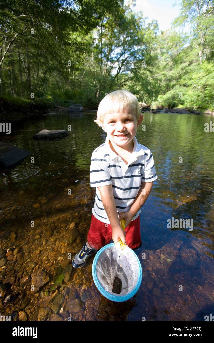 A young boy (age 3) plays in the Eightmile River in Lyme, Connecticut. The Nature Conservancy's Pleasant Valley - Stock Image