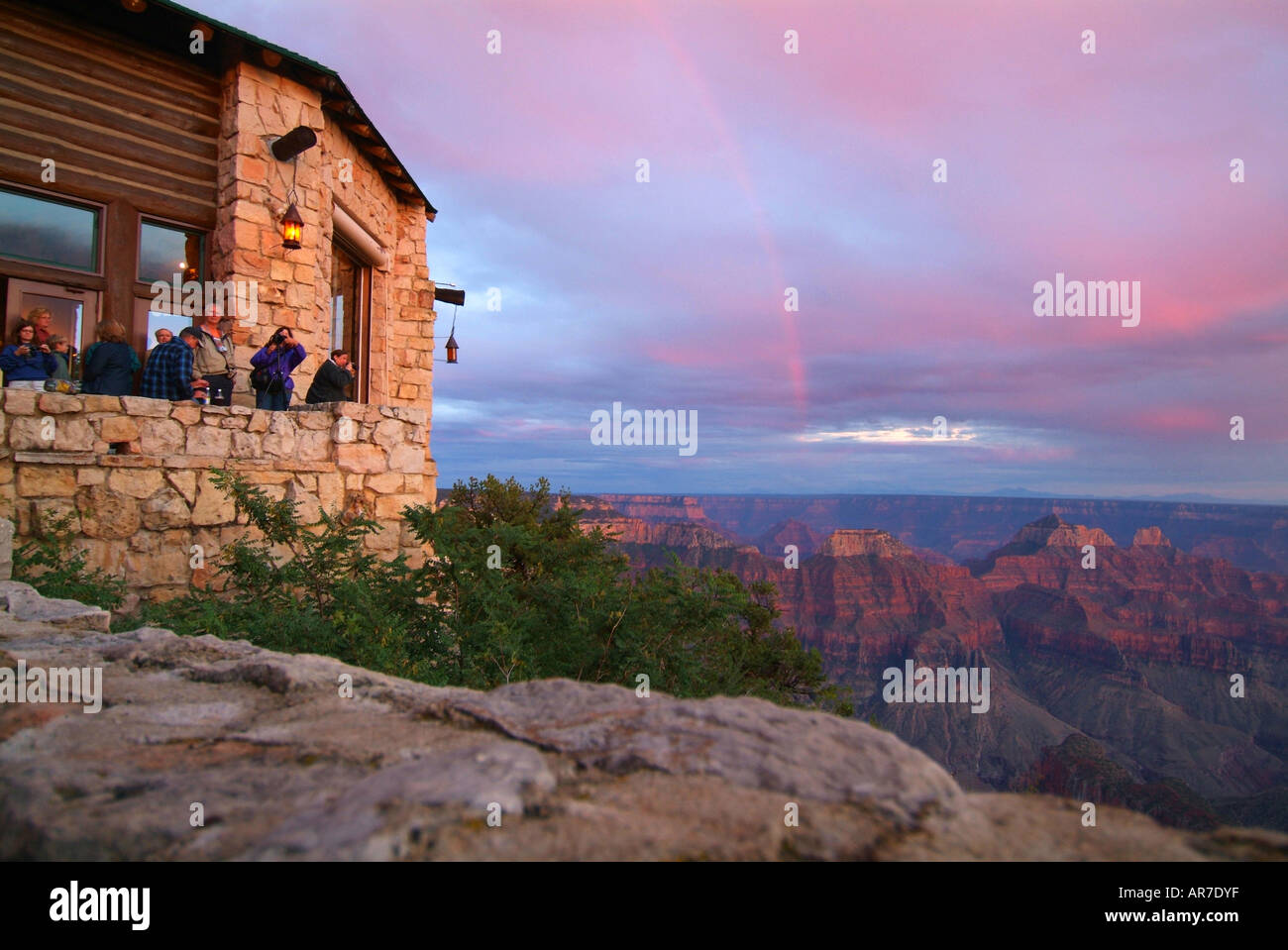 People take in the sunset from the lodge at the North Rim of the Grand Canyon National Park Service Stock Photo