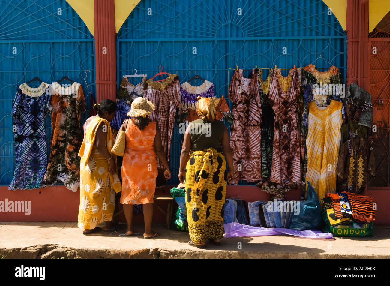 roadside store selling dresses, Hell-Ville, Nosy Be, Madagascar - Stock Image