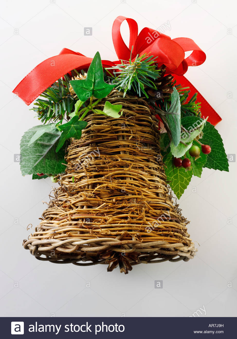 festive hand made wicker bell Christmas decoration - Stock Image