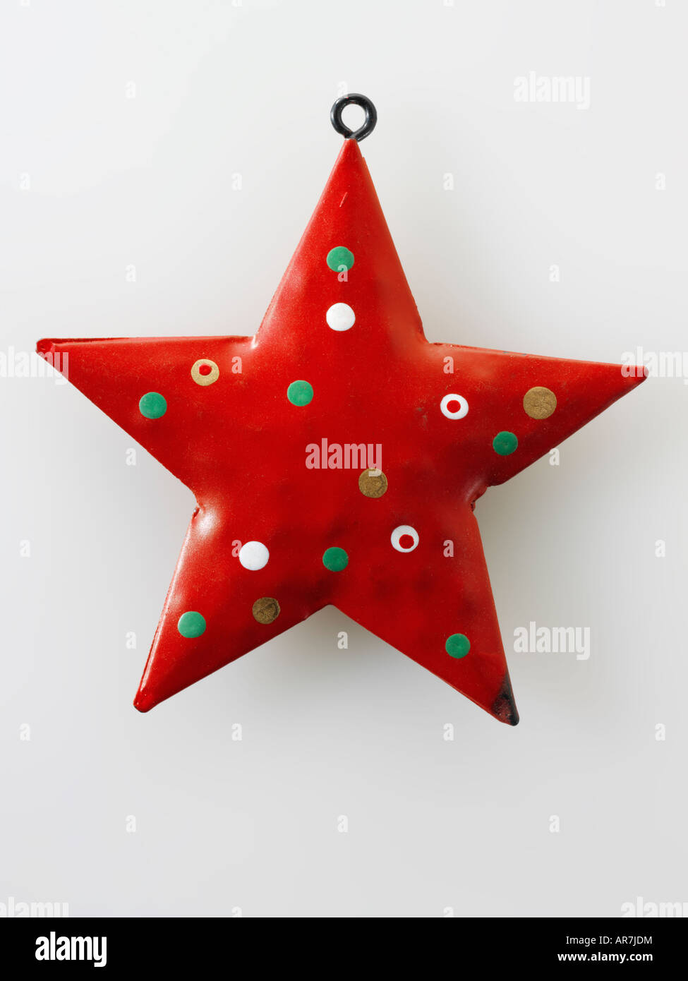festive hand painted red  star Christmas decoration - Stock Image
