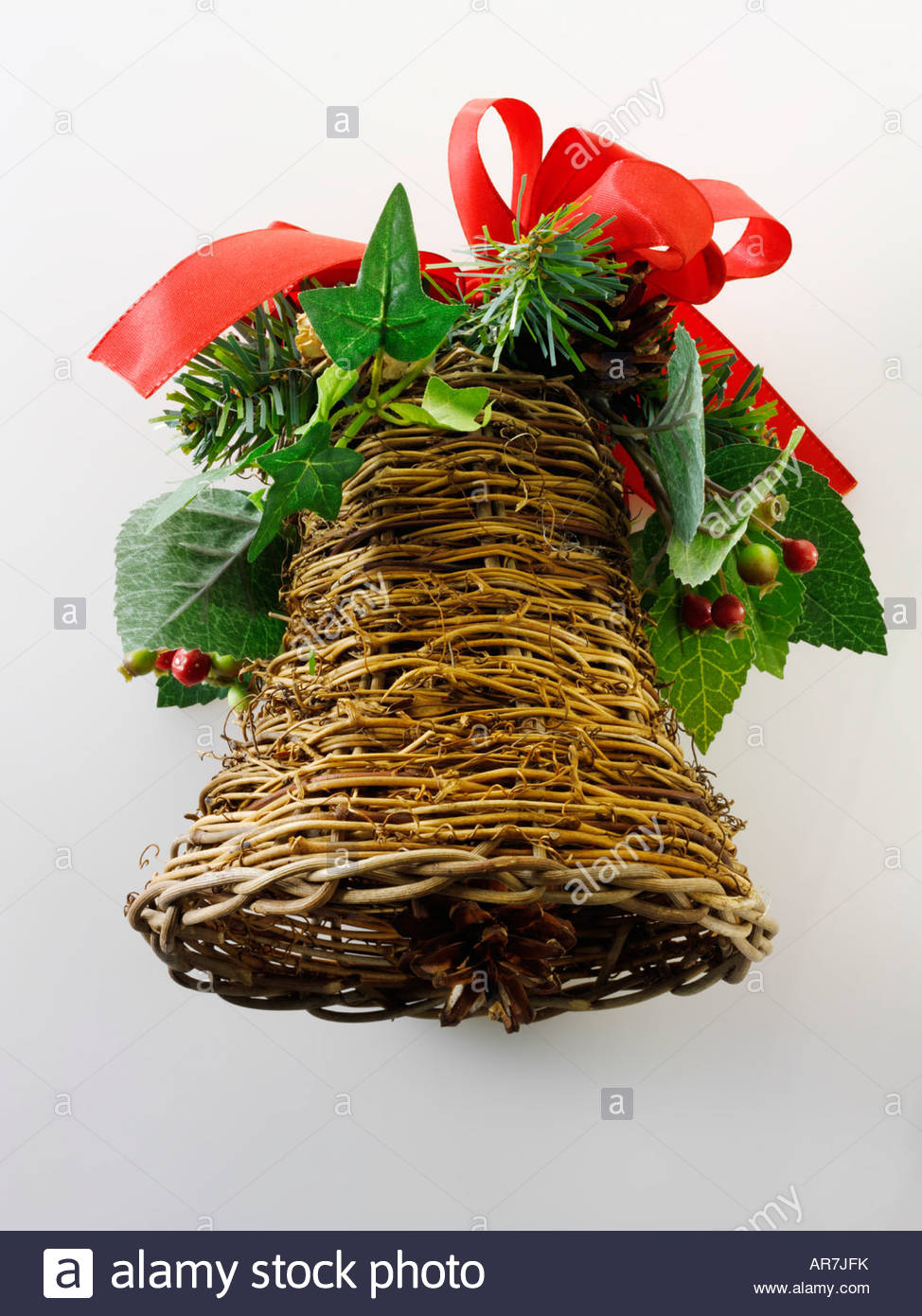 hand made wicker festive bell Christmas decoration - Stock Image