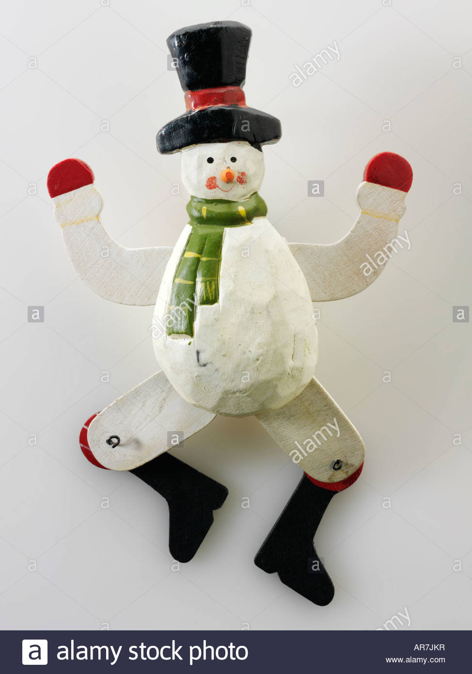 hand painted festive  wooden snowman Christmas decoration - Stock Image
