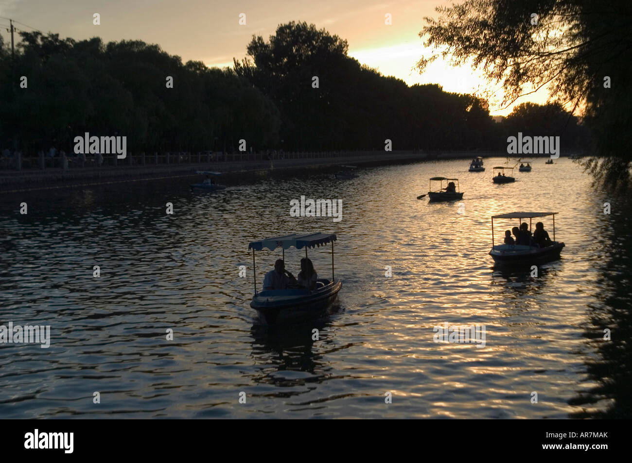 Boating on Shichahai lake behind Houhai in Beijing on a summer evening. Stock Photo