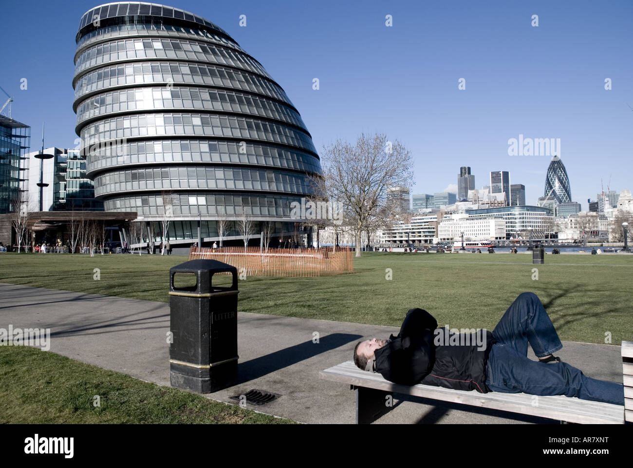 Homeless Person outside London Assembly with London s financial district The City beyond - Stock Image