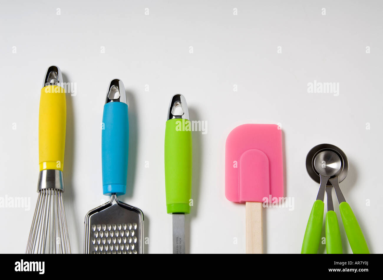 Kitchen utensils with neon accents. - Stock Image
