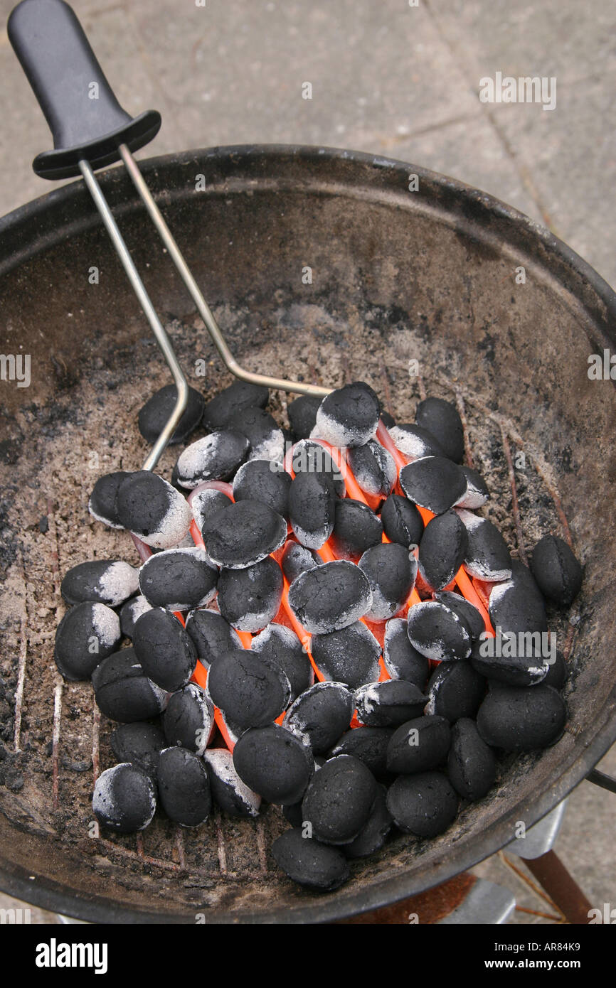 Lighting A Charcoal Grill With An Electric Heating Tool Stock Photo Alamy