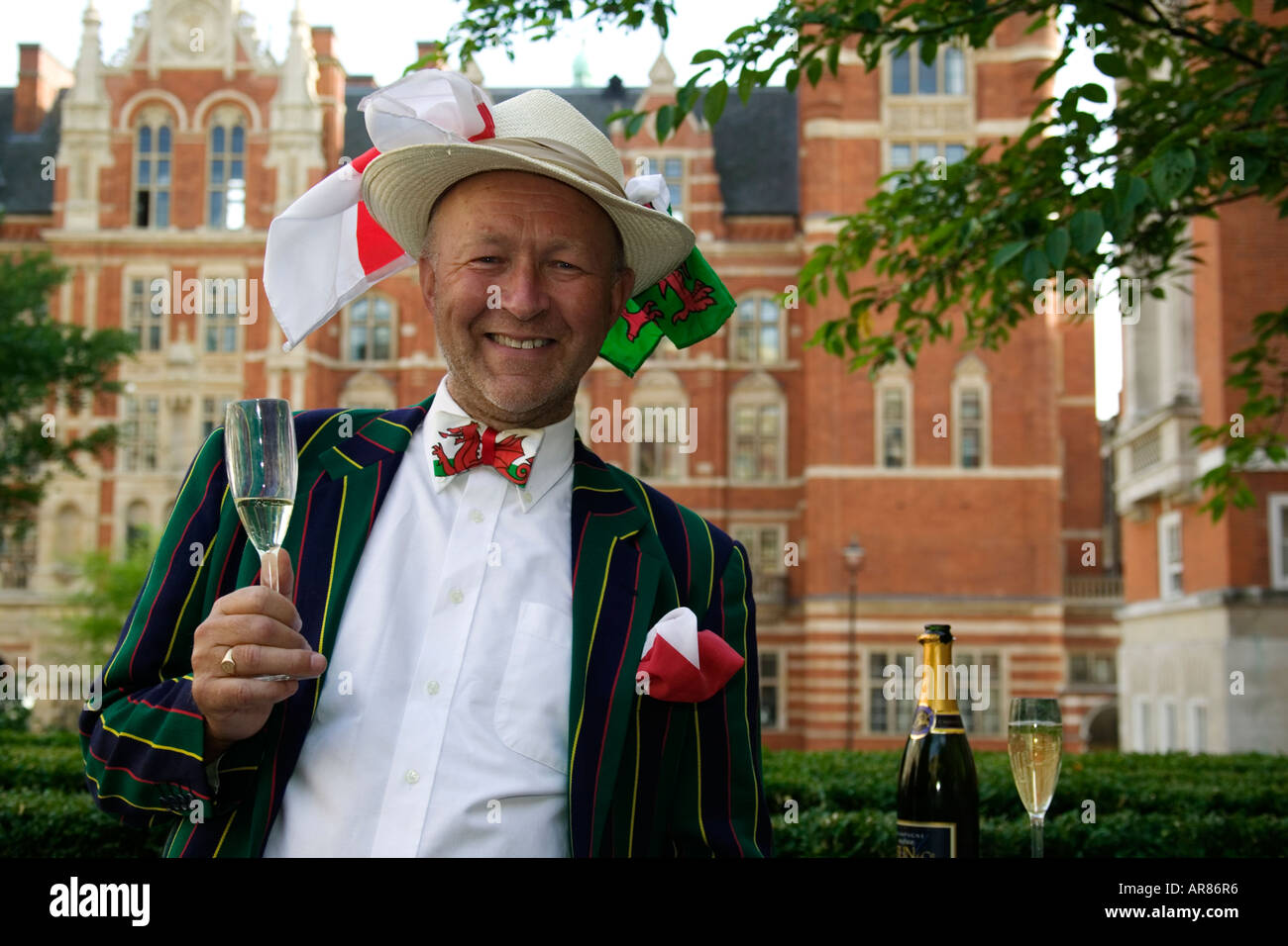Gentleman with flags on his hat and a glass of champagne at the Last Night of the Proms Stock Photo