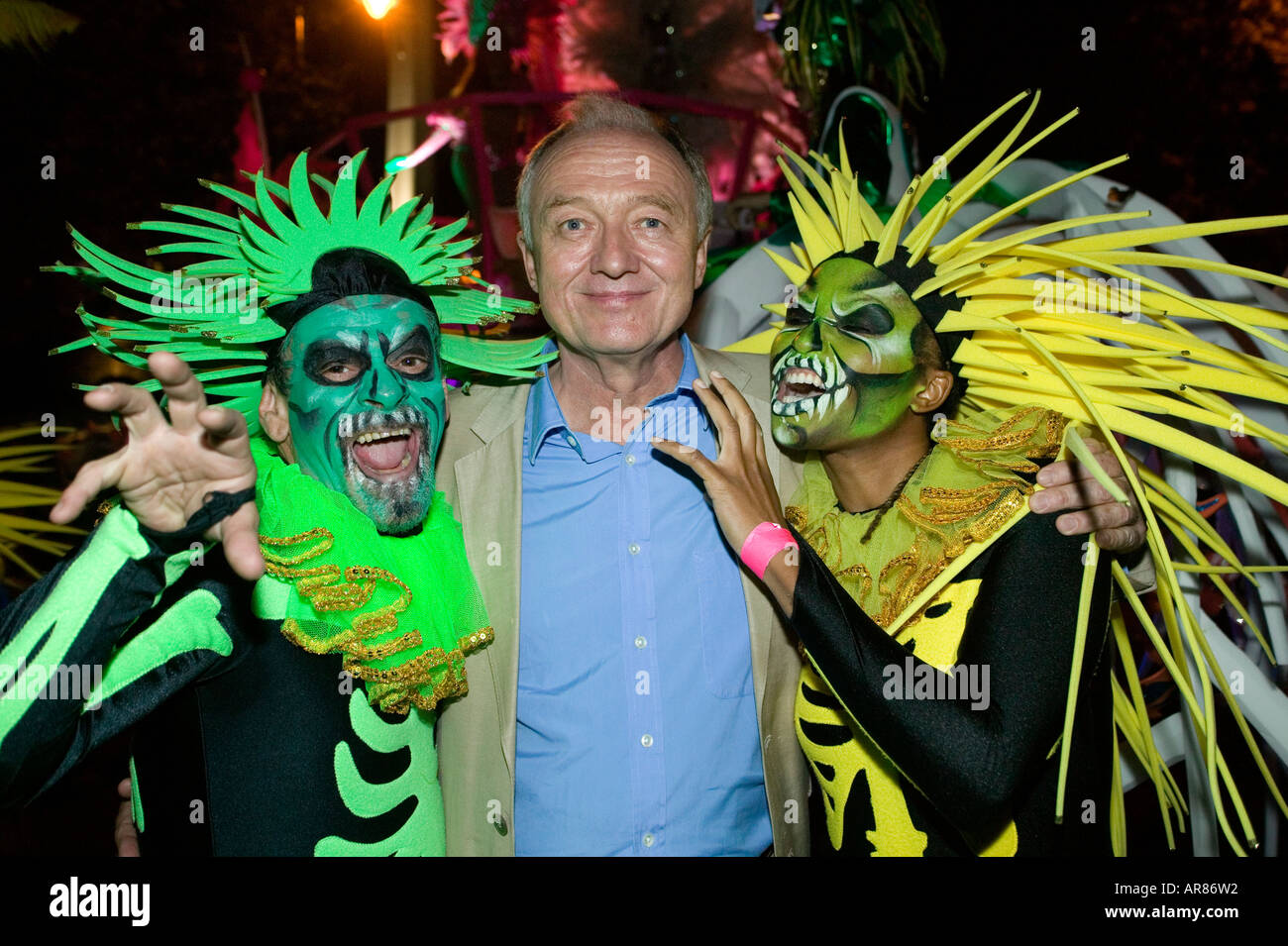 London Mayor Ken Livingstone poses with Performers at Thames Festival - Stock Image