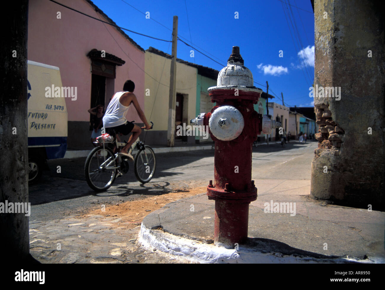 Red and white painted fire hydrant - Stock Image