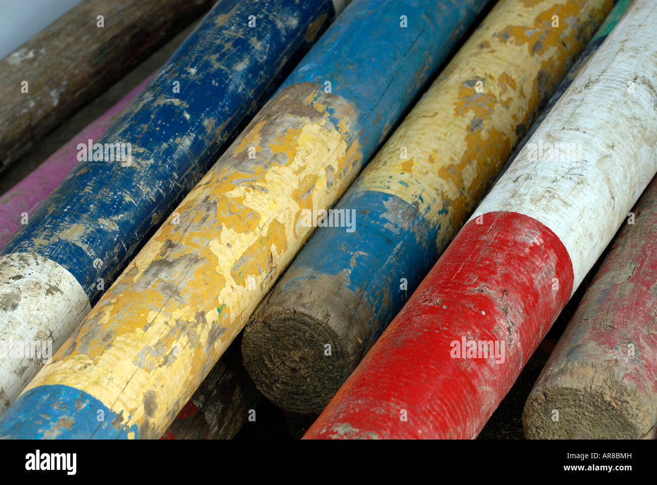 showjumping poles used for building jumps and course building for equine equestrian events stacked up ready for - Stock Image