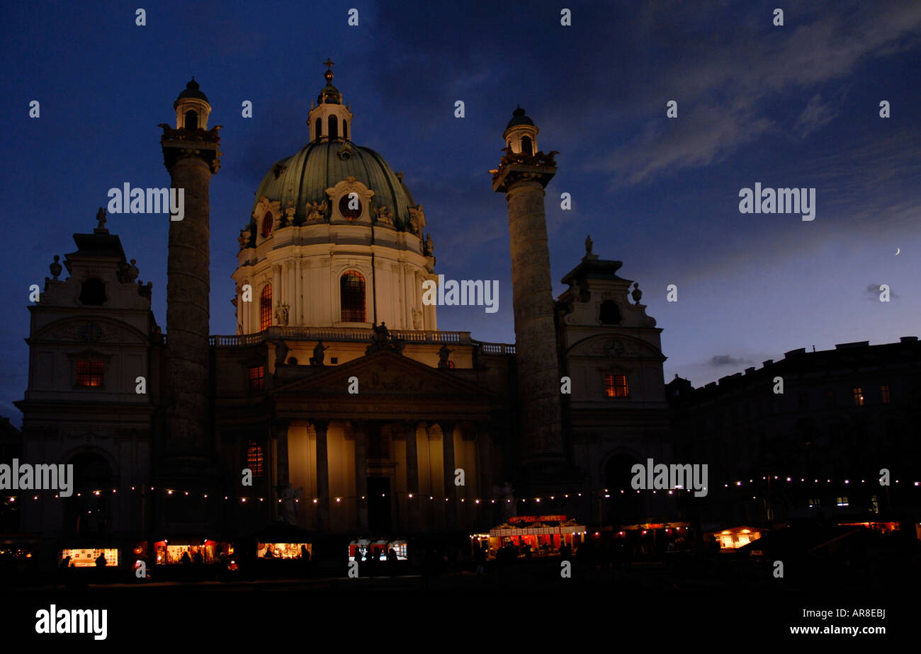 Christmas market stands in front of the Karlskirche (St. Charles' Church) in Vienna, Karlsplatz, Austria, Europe - Stock Image