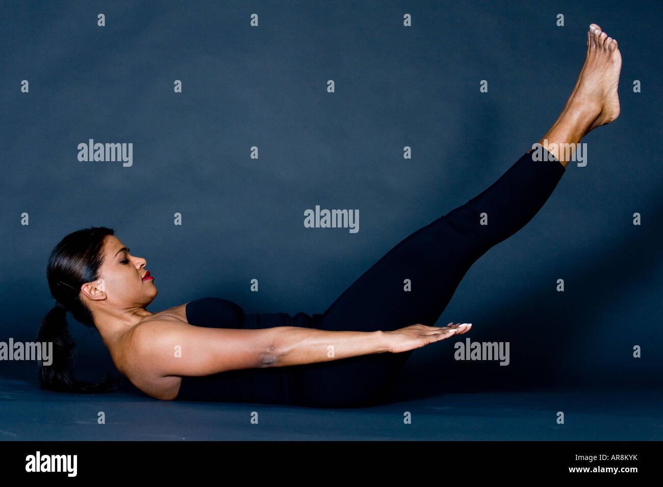 woman excercising pilates - Stock Image